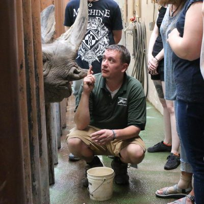 Pat Fountain with staff members and Doppsee the black rhino