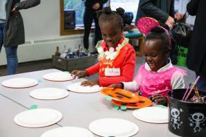Costumed children making crafts for falconers program