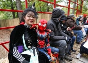 Children dressed up and on a hay-ride for Boo at the Zoo