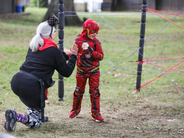 Young boy dressed as The Flash at Boo at the Zoo
