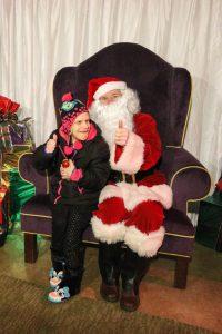 girl poses with santa